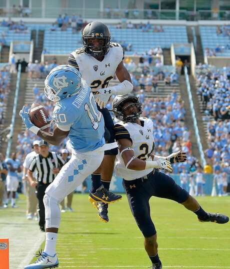 Quentin Tartabull (28) breaks up a pass in the end zone intended for North Carolina's Jordan Cunningham last Saturday. Camryn Bynum (24) trails on the play. Photo: Grant Halverson, Getty Images