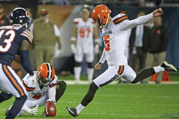 Zane Gonzalez #5 of the Cleveland Browns kicks a 53-yard field goal out of the hold of Britton Colquitt #4 against the Chicago Bears during a preseason game at Soldier Field on Aug. 31, 2017 in Chicago.