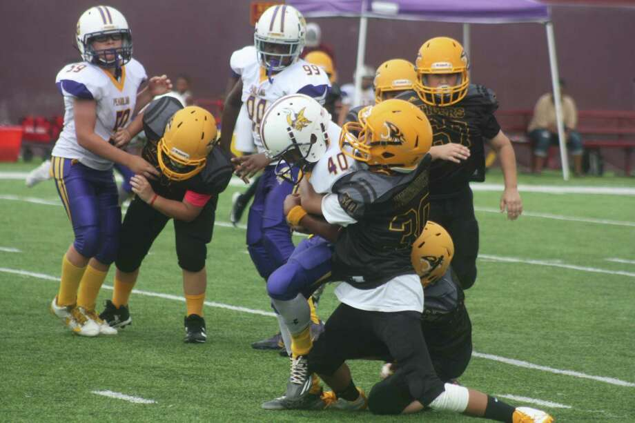 The boys who play for the Deer Park Tigers and Rams would love to get back on the football field as soon as possible after Harvey wiped out action the last two weeks. Photo: Robert Avery