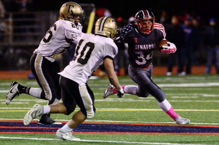 Brien McMahon's #34 Michael Macari looks for running room as Brien McMahon High School football takes on Trumbull Friday, October 28, 2016, in Norwalk, Conn. Photo: Erik Trautmann / Hearst Connecticut Media / Norwalk Hour