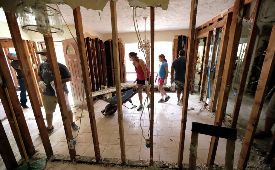 Volunteers help clean up a home destroyed by floodwaters in the aftermath of Hurricane Harvey on Sunday, Sept. 3, 2017, in Spring, Texas. (AP Photo/David J. Phillip) Photo: David J. Phillip, STF / Copyright 2017 The Associated Press. All rights reserved.