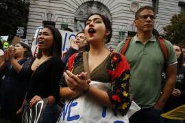 Alexandria Tagaloa of USF's MECHA club protests outside the San Francisco Federal Building on Tuesday, Sept. 5, 2017, in San Francisco, Calif. Demonstrators rallied in support of the Deferred Action for Childhood Arrivals (DACA) program, which the Trump administration said will phase out in six months.