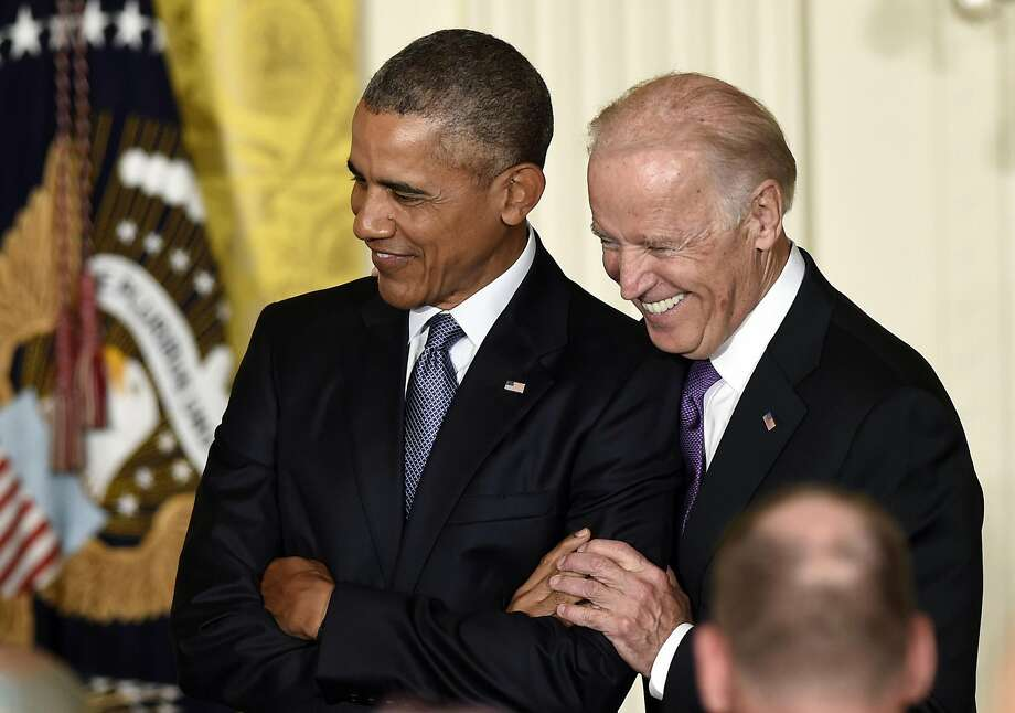 Joe Biden is known for his hands-on approach to politics, including with his old boss, President Barack Obama. Photo: Susan Walsh / Associated Press 2015