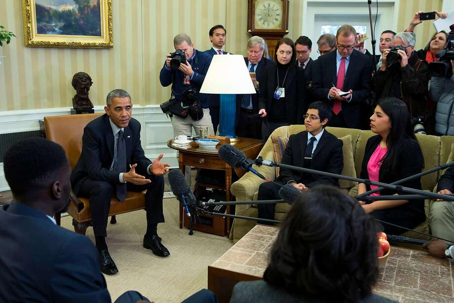 President Barack Obama meets with a group of beneficiaries of the Deferred Action for Childhood Arrivals in the Oval Office in 2015. Other Obama-era rules are being reconsidered. Photo: Evan Vucci, Associated Press