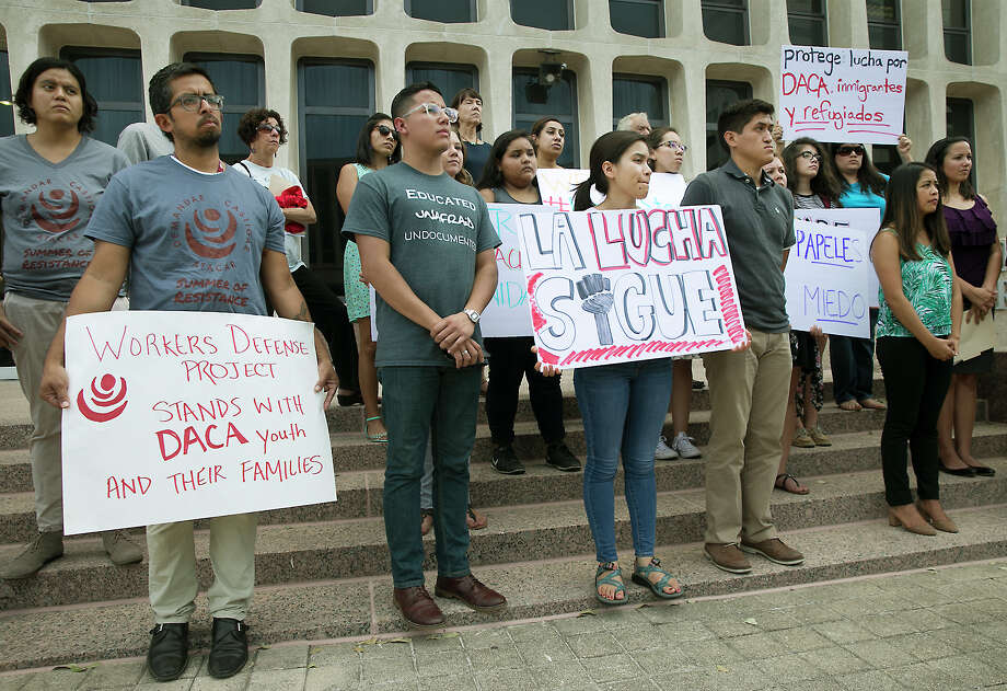 Demonstrators gathered on the plaza of the J.J.Pickle Federal Building in Austin Tuesday to protest President Donald Trump's decision to rescind the Deferred Action for Childhood Arrivals (DACA) program.  (Ralph Barrera/Austin American-Statesman via AP) Photo: Ralph Barrera, MBO / Austin American-Statesman