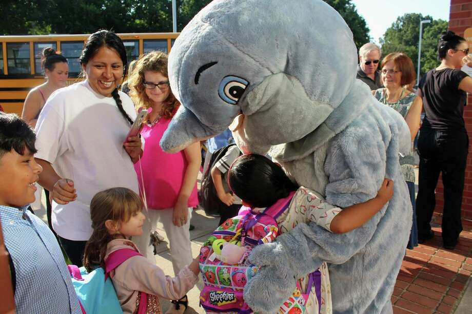 Students were greeted by the school mascot, Bubbles, as they arrive for the first day of classes at McKinley School in Fairfield last week. Photo: Genevieve Reilly / Hearst Connecticut Media / Fairfield Citizen