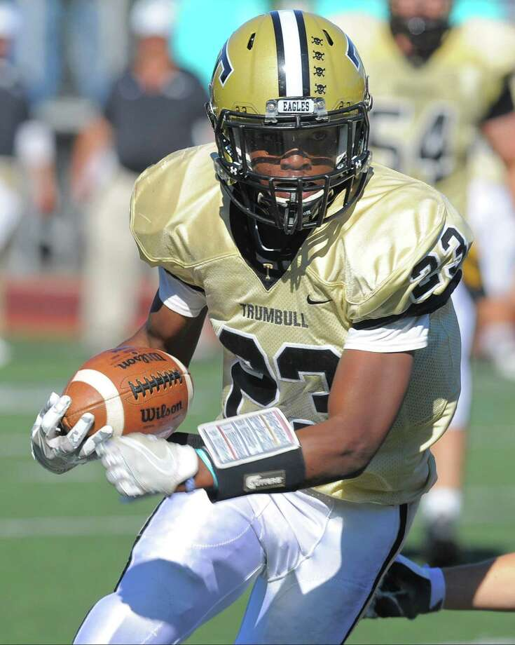 Trumbull senior running back Markeese Woods is a threat to score every time he touches the ball. Photo: Matthew Brown / Hearst Connecticut Media / Stamford Advocate
