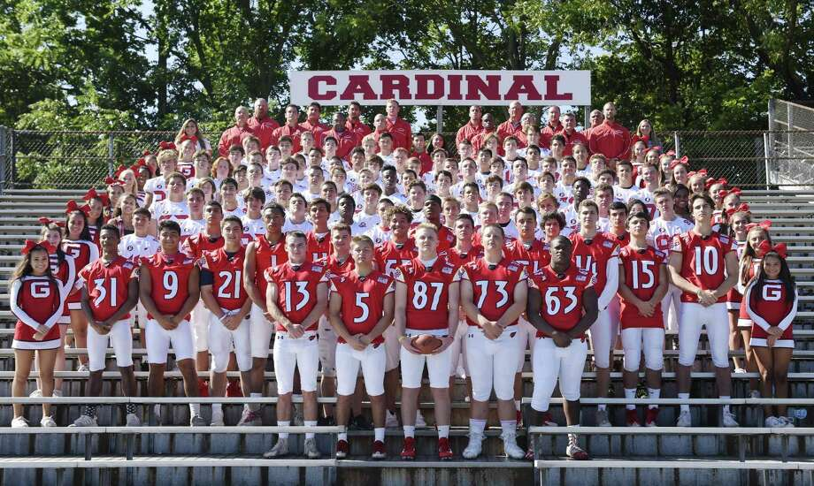 The 2017 Greenwich High School football team, coaches and cheerleaders pose for a team photo on media day at Greenwich High School's Cardinal Stadium in Greenwich, Conn. Sunday, Aug. 20, 2017. Photo: Tyler Sizemore / Hearst Connecticut Media / Greenwich Time