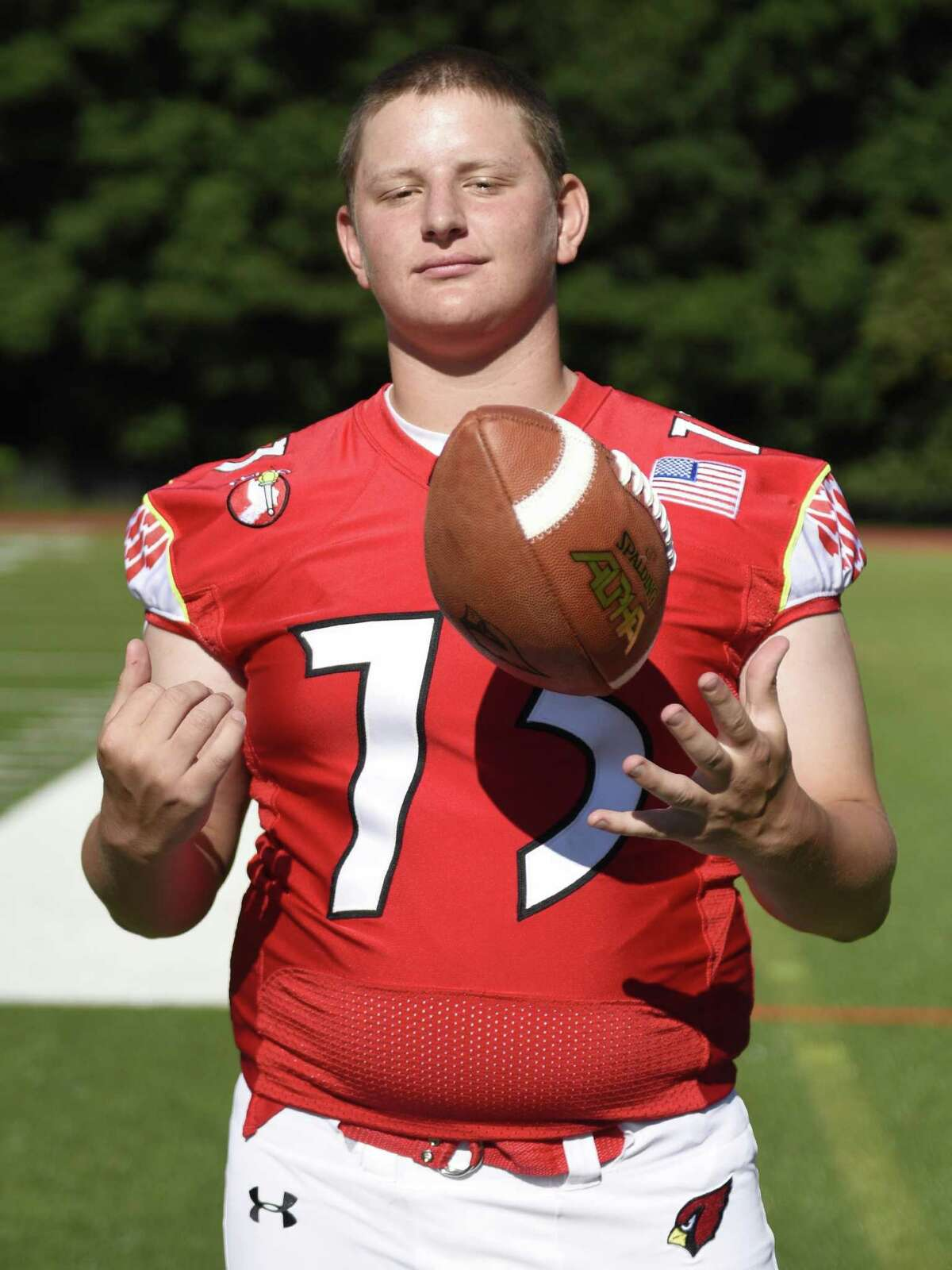 Senior team captain offensive lineman Kyle Woodring (73) poses on 2017 Greenwich High School football media day at Greenwich High School's Cardinal Stadium in Greenwich, Conn. Sunday, Aug. 20, 2017.