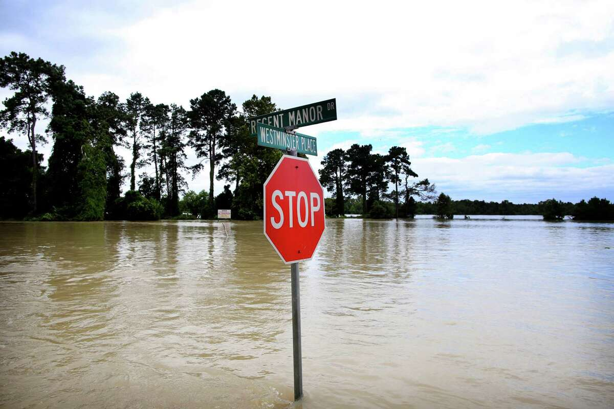 A street sign in a flooded neighborhood of The Woodlands, north of Houston, on Wednesday, Aug. 30, 2017. Waters began to recede in parts of flood-ravaged Houston on Wednesday as Tropical Storm HarveyÂ?'s wrath shifted east. (Barbara Davidson/The New York Times)