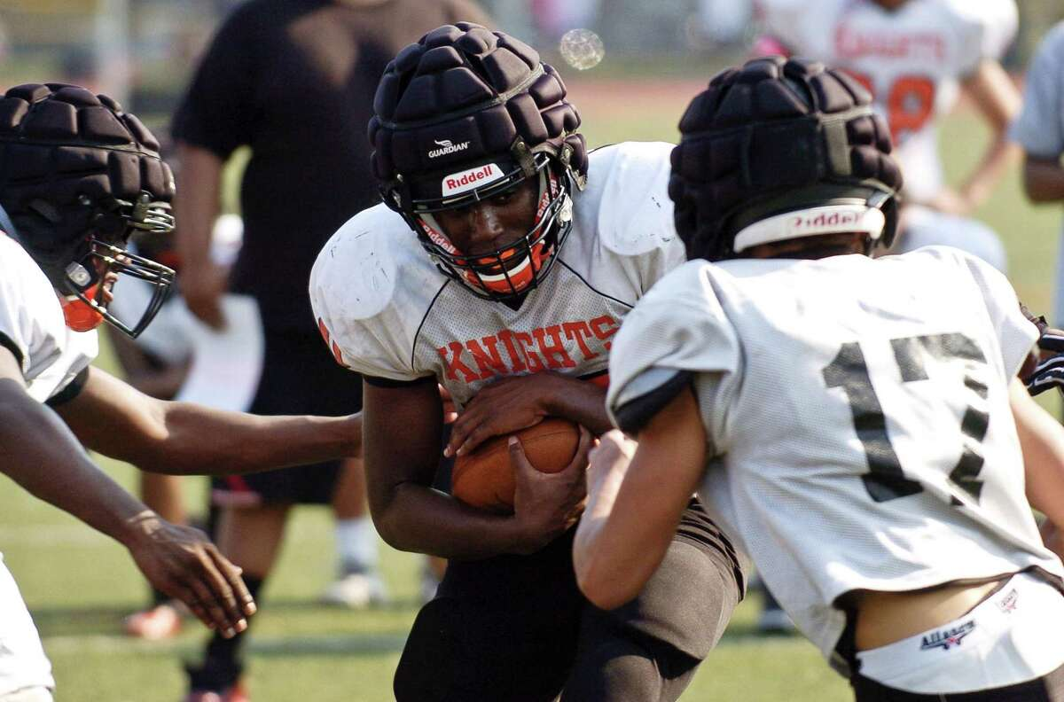 Stamford runningback Camron Frekleten carries the ball during a team practice at Stamford High School's Boyle Stadium in Stamford, Connecticut on Tuesday, Sept. 5, 2017.