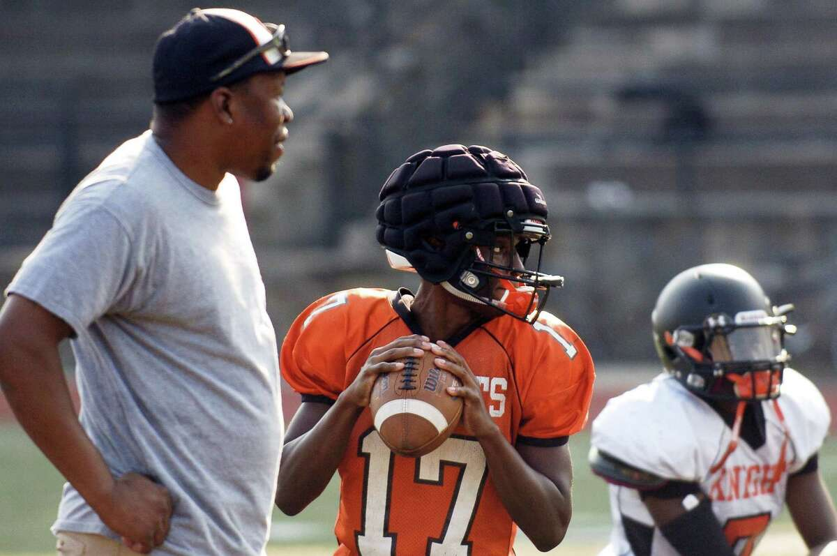 Stamford quarterback Terry Forrester looks for the receiver as coach Jamar Greene works on his offense during a team practice at Stamford High School's Boyle Stadium in Stamford, Connecticut on Tuesday, Sept. 5, 2017.