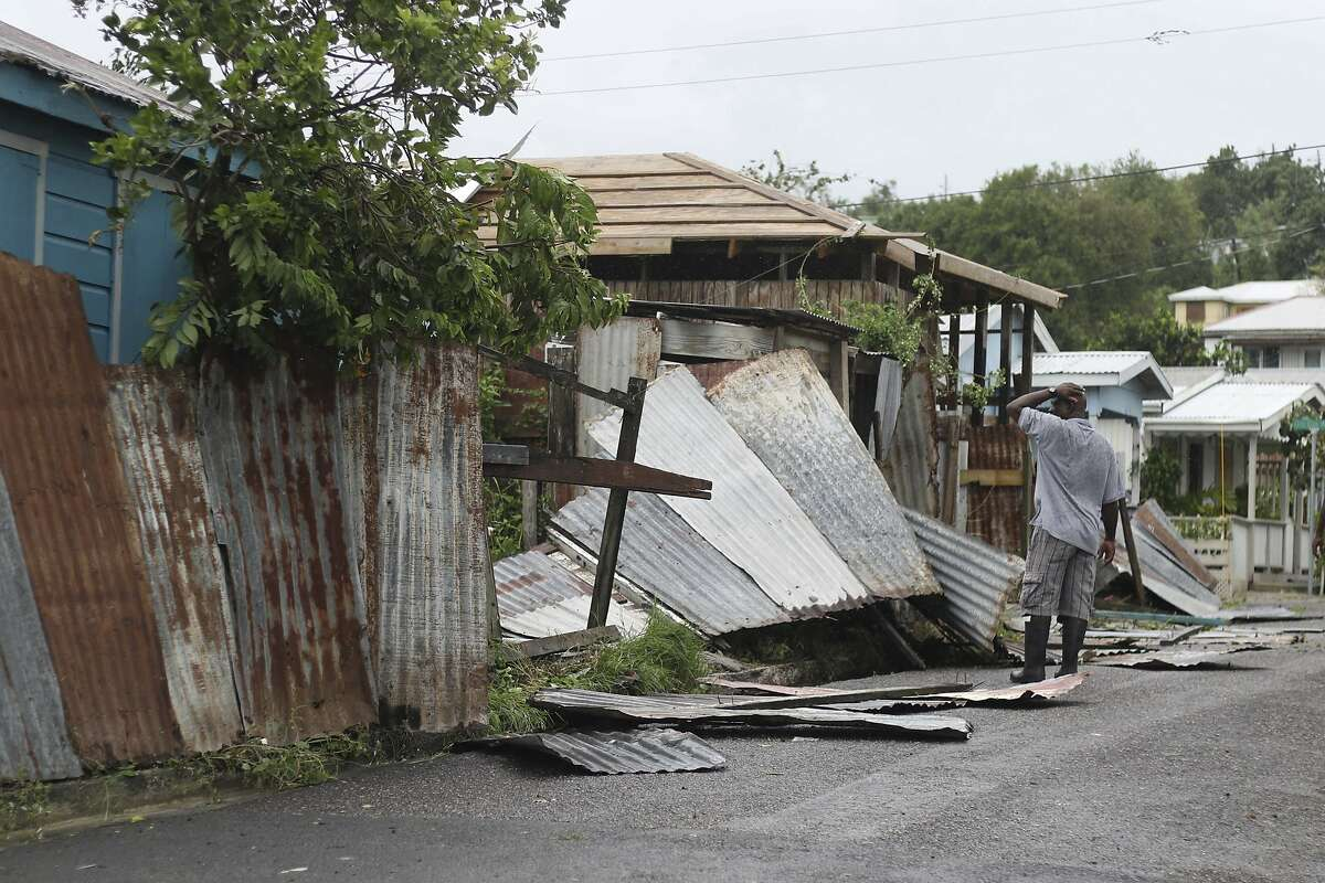 A man surveys the wreckage on his property after the passing of Hurricane Irma, in St. John's, Antigua and Barbuda, Wednesday, Sept. 6, 2017. Heavy rain and 185-mph winds lashed the Virgin Islands and Puerto Rico's northeast coast as Irma, the strongest Atlantic Ocean hurricane ever measured, roared through Caribbean islands on its way to a possible hit on South Florida.