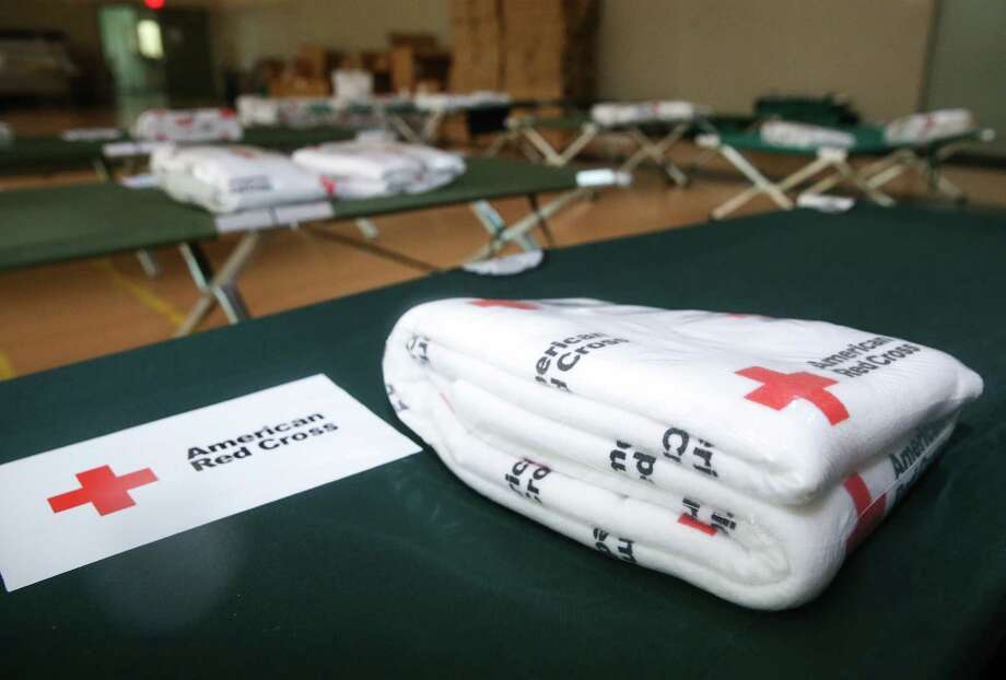 Food, supply and bed are prepared at the American Red Cross shelter on 28th Street on Saturday, August 25, 2017 in Galveston. As of Saturday afternoon, three guests have checked in to their service. ( Yi-Chin Lee / Houston Chronicle) Photo: Yi-Chin Lee / Houston Chronicle, Harvey / Houston Chronicle 2017