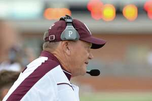 Head Coach Don Clayton of the Cinco Ranch Cougars surveys his team prior to the start of their high school football game versus the Cy Ranch Mustangs on Friday, August 26, 2015 at Rhodes Stadium.