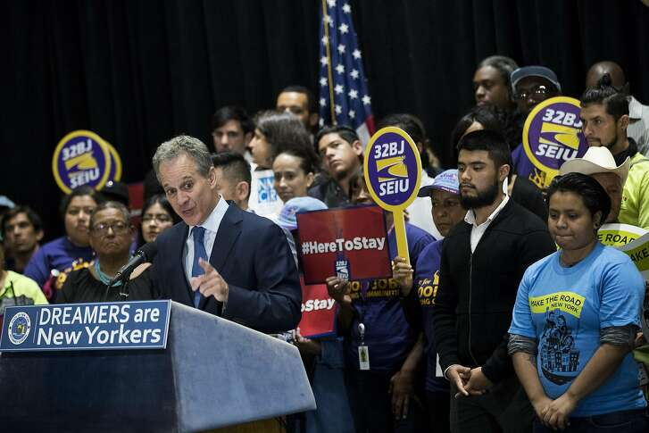 NEW YORK, NY - SEPTEMBER 6: Surrounded by DACA recipients and immigration activists, New York Attorney General Eric Schneiderman speaks during a press conference to announce the filing of a multi-state lawsuit to protect DACA recipients, at John Jay College of Criminal Justice, September 6, 2017 in New York City. New York and 14 other states and the District of Columbia filed a lawsuit in U.S. District Court in Brooklyn on Wednesday. The suit seeks to preserve the Deferred Action for Childhood Arrivals (DACA) program that was created in 2012. (Photo by Drew Angerer/Getty Images)