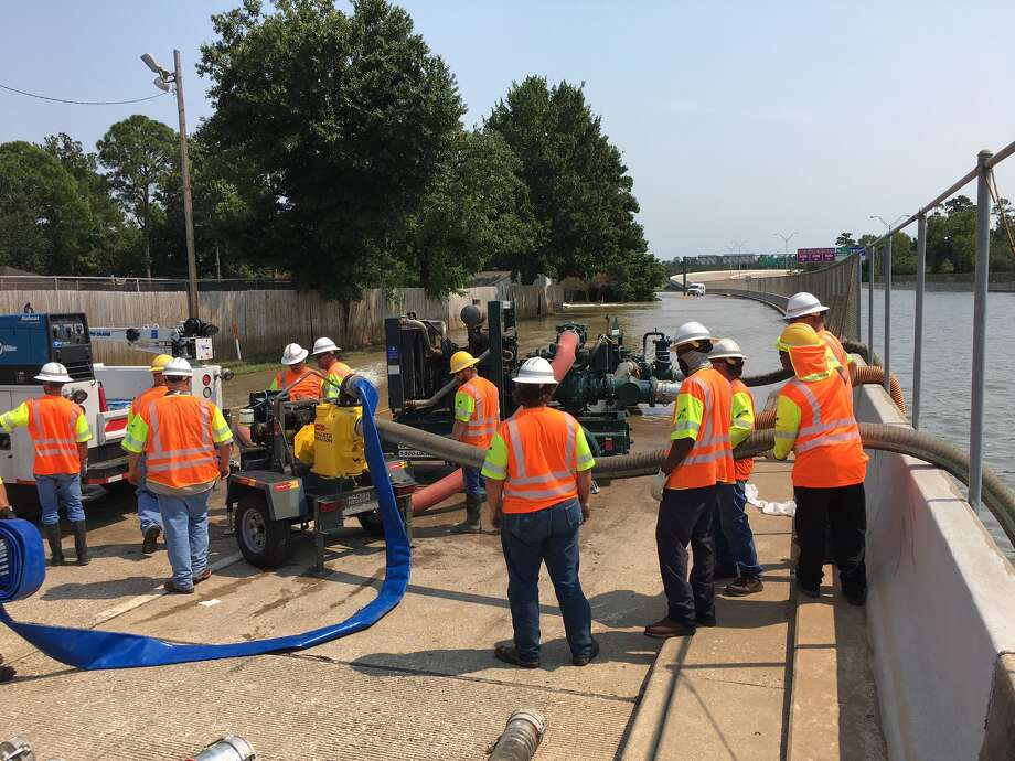 A Texas Department of Transportation crew uses a portable pump to bring water from the depressed section of the Sam Houston Tollway south of Interstate 10 to the frontage road, where it will flow to Buffalo Bayou on Wednesday.See some of the epic memes that have been inspired by Houston's terrible traffic jams...