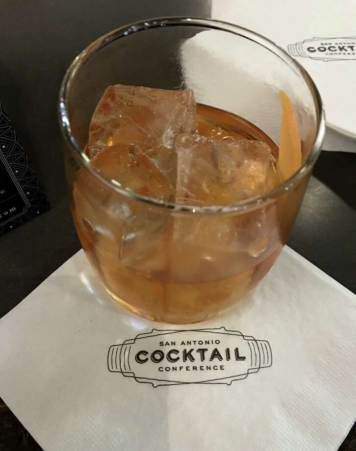 On Wednesday, Sept. 6, the San Antonio Cocktail Conference unveiled its 2018 signature cocktail, the Tío Mío. It's an updated old fashioned, with Herradura Añejo tequila, agave nectar, Angostura bitters, chocolate bitters and the oil from a grapefruit peel. Photo: Emily Spicer / San Antonio Express-News, San Antonio Express-News / San Antonio Express-News