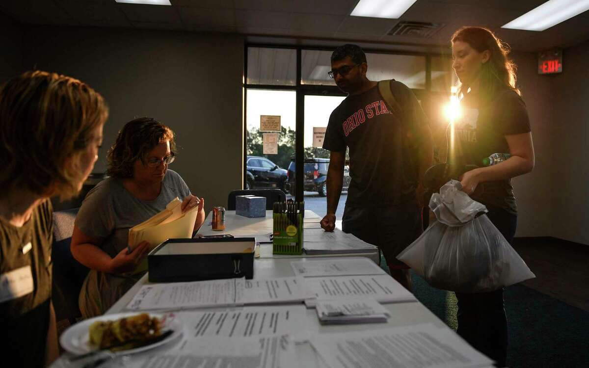Nash and Stephanie Ubale check in with the help desk at Houston's Calvary Community Church before heading to their flood-damaged home. Calvary had been operating as a shelter ever since Jeff McGee, the church's senior pastor, realized that the official Red Cross facilities in northwest Houston might not have enough room. Must credit: Washington Post photo by Ricky Carioti