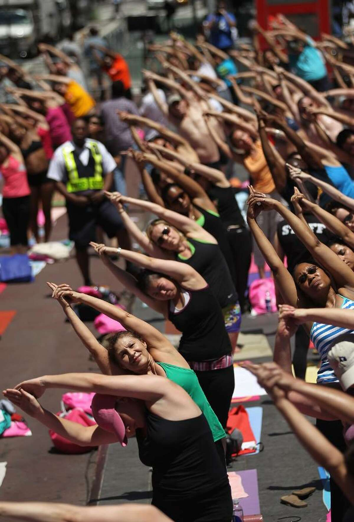 NEW YORK - JUNE 21: Yoga enthusiasts participate in the free annual 'Summer Solstice in Times Square Yoga-thon' June 21, 2010 in New York City. The summer solstice is the first official day of summer and the longest day of the year. (Photo by Mario Tama/Getty Images)
