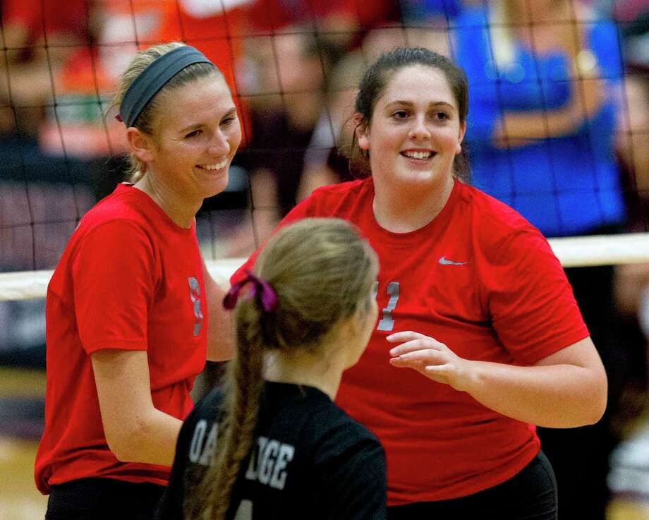 Oak Ridge setter Carly Graham (11) and Molly Russell (6) smile after connecting for a point during the second set of a non-district high school volleyball match, Wednesday, Sept. 6, 2017, in Magnolia. Oak Ridge defeated Magnolia in straight sets. Photo: Jason Fochtman, Staff Photographer / © 2017 Houston Chronicle