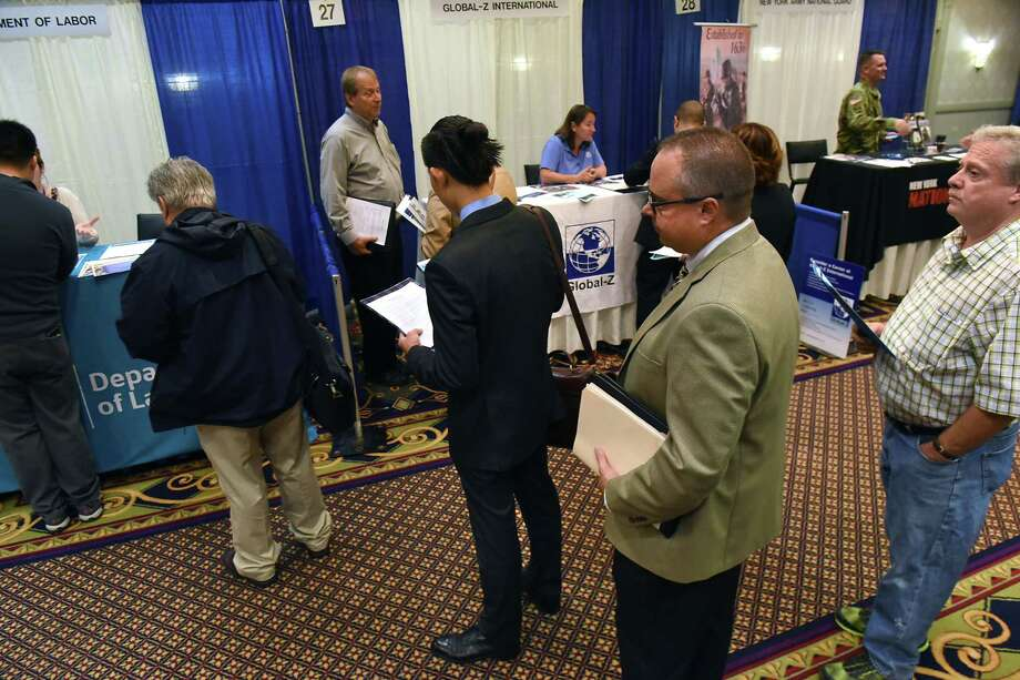 Job seekers line up to talk to a representative from the Department of Labor at the Times Union Technology & Manufacturing Job Fair at the Albany Marriott hotel on Wednesday, Sept. 6, 2017 in Colonie, N.Y. (Lori Van Buren / Times Union) Photo: Lori Van Buren / 20041474A