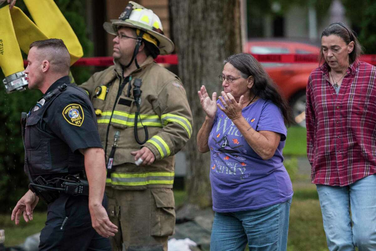 Hudson Falls police and fire officials as fire investigators work to determine the cause of a fatal fire that consumed a two story wood frame structure at 11 North Street Wednesday Sept. 6, 2017 in Hudson Falls, N.Y. (Skip Dickstein/Times Union)
