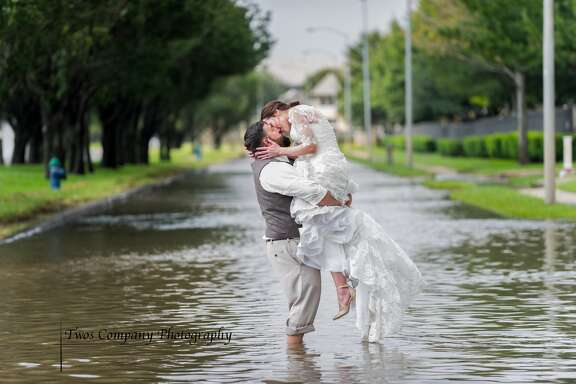 Photographers Andi and Jim Davis took this now-viral photo of newlyweds Shelley and Chris Holland, days after Hurricane Harvey devastated Houston.