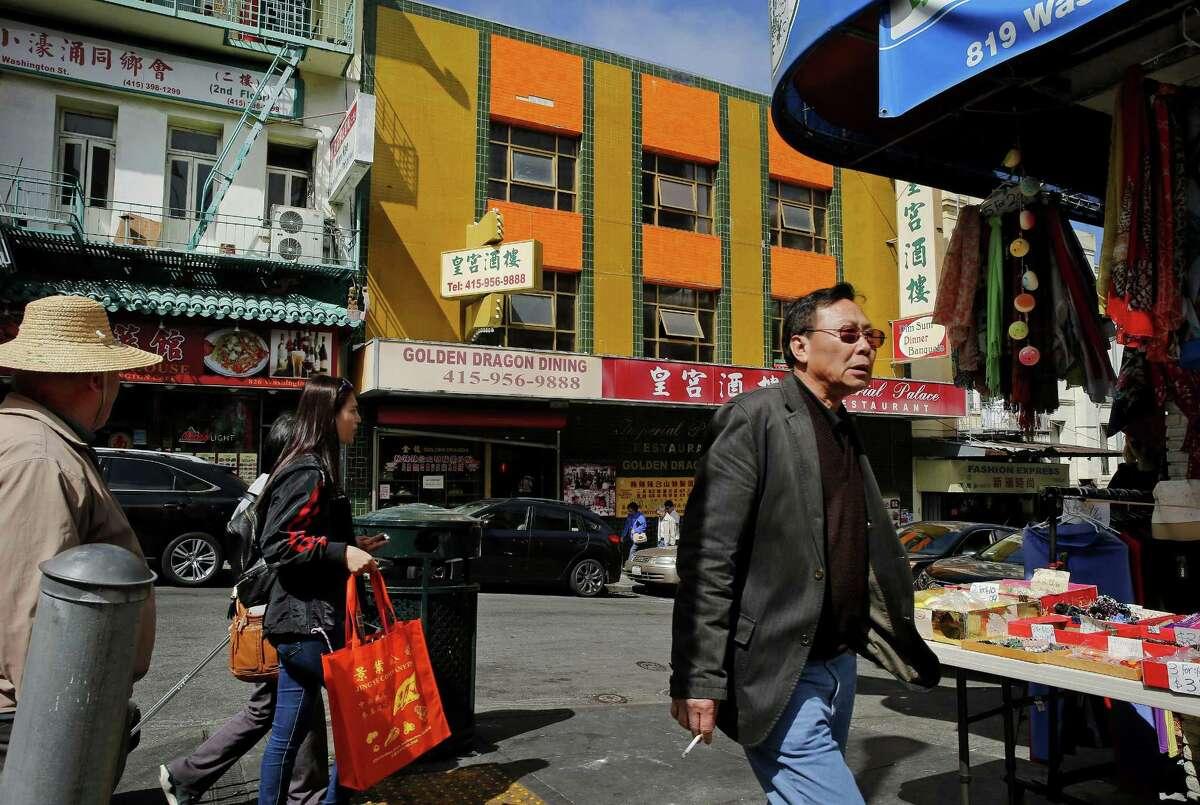 Pedestrians make their way through San Francisco's Chinatown.