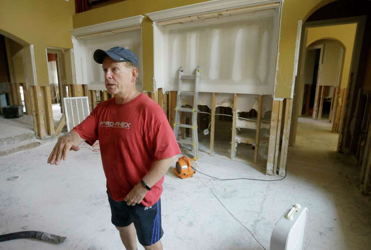 Tom Mayne, a member of Champion Forest Baptist, 15555 Stuebner Airline Rd., talks about the flooding in his home and the church crews who are helping with the cleanup Tuesday, Sept. 5, 2017, in Houston from the aftermath of flood following Hurricane Harvey. ( Melissa Phillip / Houston Chronicle )
