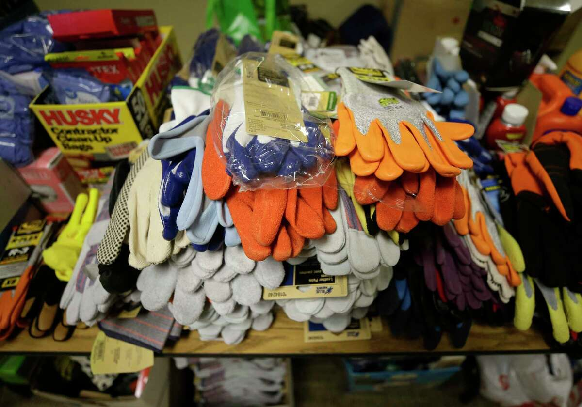 Gloves and other supplies are arranged for volunteers to pick up at Champion Forest Baptist, 15555 Stuebner Airline Rd., as they mobilize for home cleanup Tuesday, Sept. 5, 2017, in Houston from the aftermath of flood following Hurricane Harvey. ( Melissa Phillip / Houston Chronicle )