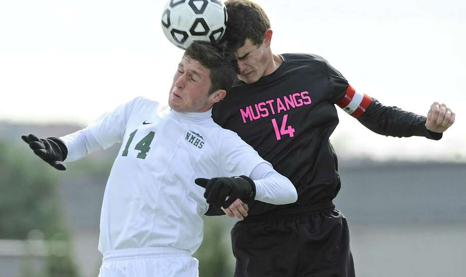 New Milford's Shane Fedigan (14) is back to lead a talented team. The senior striker was a first-team All-SWC selection and the leading scorer last year on a team which went to the SWC title game. Photo: H John Voorhees III / Hearst Connecticut Media / The News-Times
