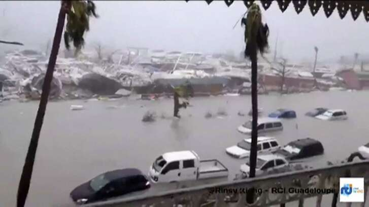 A handout grab image made from a video released on Wednesday by RCI Guadeloupe shows flooded streets and damage on the French overseas island of Saint-Martin, filmed from a terrace of the Beach Plaza hotel after high winds from Hurricane Irma hit the island. Monster Hurricane Irma slammed into Caribbean islands Wednesday after making landfall in Barbuda, packing ferocious winds and causing major flooding in low-lying areas. As the rare Category Five storm barreled its way across the Caribbean, it brought gusting winds of up to 185 miles per hour (294 kilometers per hour), weather experts said.