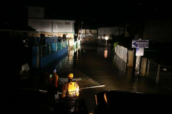 FAJARDO, PUERTO RICO - SEPTEMBER 06: A rescue team from the local emergency management agency inspects flooded areas after the passing of Hurricane Irma on September 6, 2017 in Fajardo, Puerto Rico. The category 5 storm is expected to pass over Puerto Rico and the Virgin Islands today, and make landfall in Florida by the weekend. (Photo by Jose Jimenez/Getty Images)