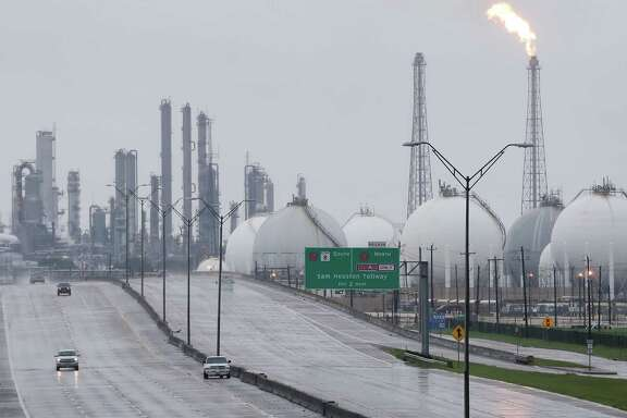 A flare is seen Aug. 29 at Shell's Deer Park refinery, where two tanks were damaged by the storm. Several plants shut down after Hurricane Harvey made landfall are coming back on line.