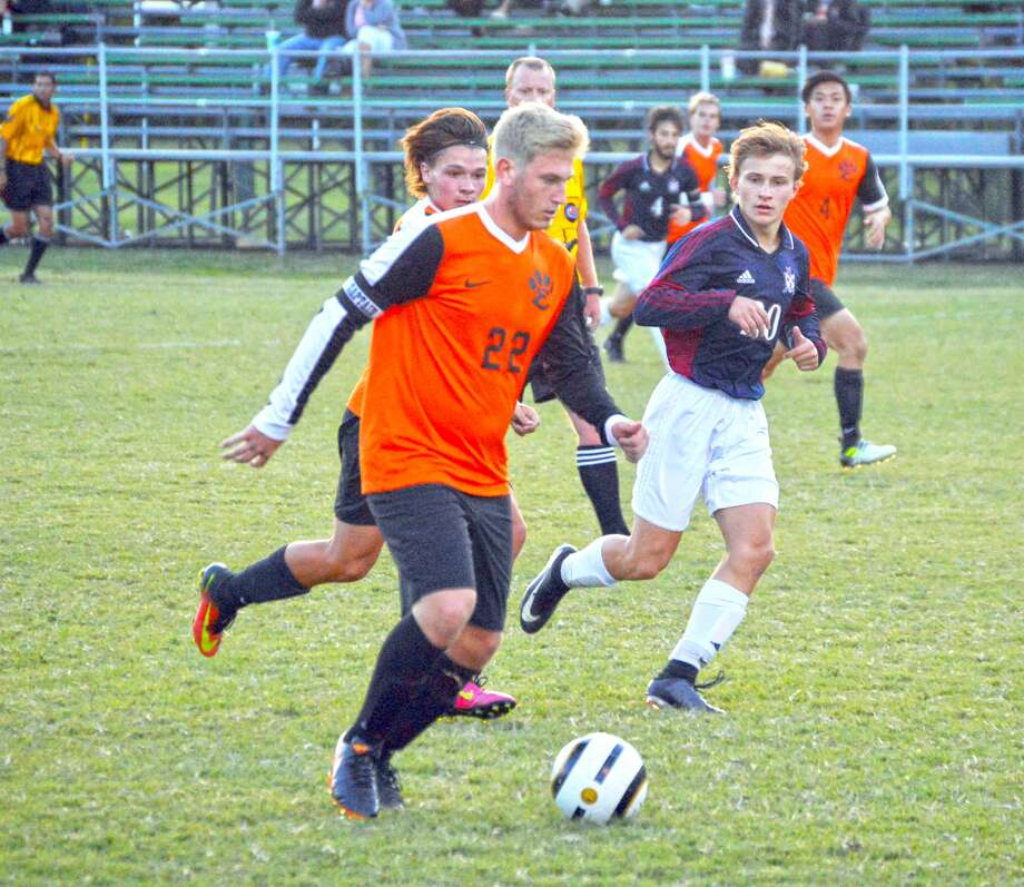 Edwardsville senior forward Alec Mills dribbles the ball up the field against Waterloo Gibault midway through the first half of Wednesday's game in Columbia.