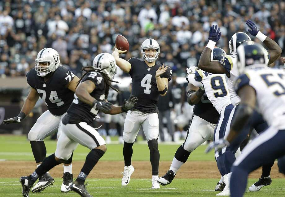 Oakland Raiders quarterback Derek Carr (4) passes against the Los Angeles Rams during the first half of an NFL preseason football game in Oakland, Saturday, Aug. 19, 2017. (AP Photo/Rich Pedroncelli) Photo: Rich Pedroncelli / AP / Copyright 2017 The Associated Press. All rights reserved.