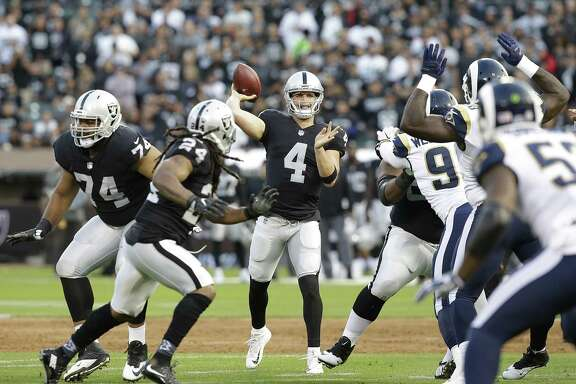 Oakland Raiders quarterback Derek Carr (4) passes against the Los Angeles Rams during the first half of an NFL preseason football game in Oakland, Saturday, Aug. 19, 2017. (AP Photo/Rich Pedroncelli)