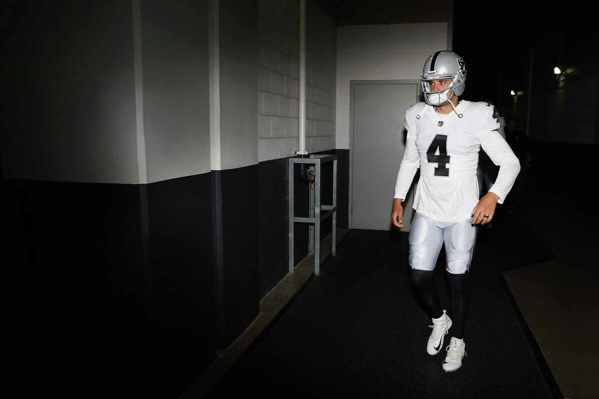 GLENDALE, AZ - AUGUST 12: Quarterback Derek Carr #4 of the Oakland Raiders walks out onto the field before the NFL game against the Arizona Cardinals at the University of Phoenix Stadium on August 12, 2017 in Glendale, Arizona. (Photo by Christian Petersen/Getty Images)