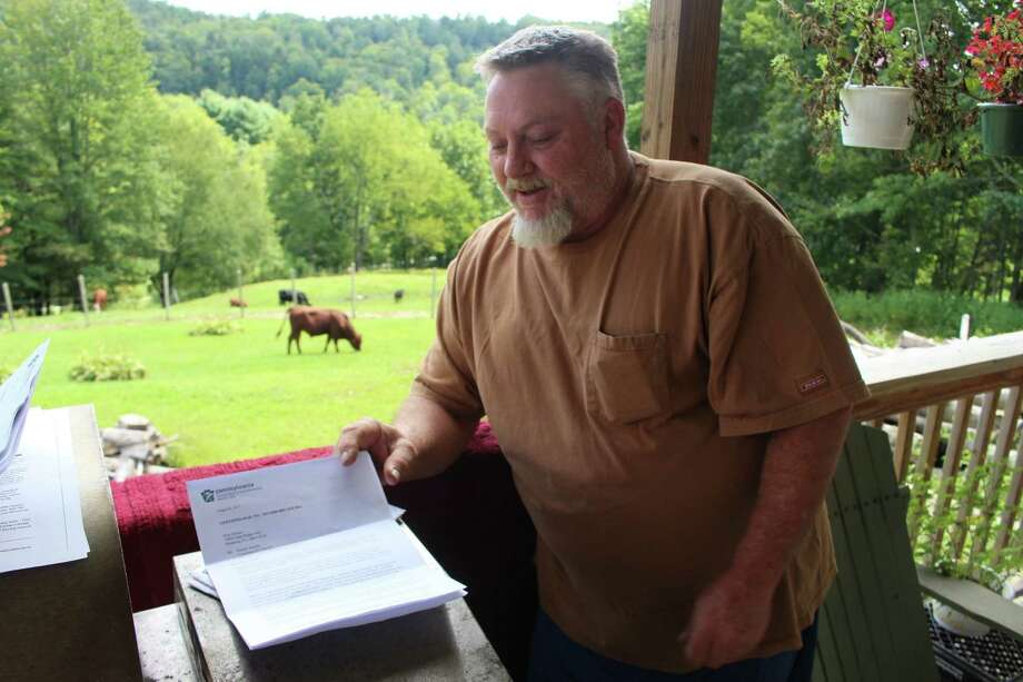 Ken Morcom refers to a letter from the Pennsylvania Department of Environmental Protection as he speaks about the contamination of his water well at his home in Dimock, Pa. The federal government is back for the first time in more than five years to investigate ongoing claims of contamination in Dimock, which became a battleground in the debate over gas drilling and fracking. Photo: Michael Rubinkam, Associated Press / ap