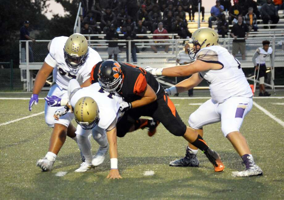 Edwardsville's Josh Anderson sacks CBC quarterback Brett Gabbert in the second quarter of a home game on Sept. 1.