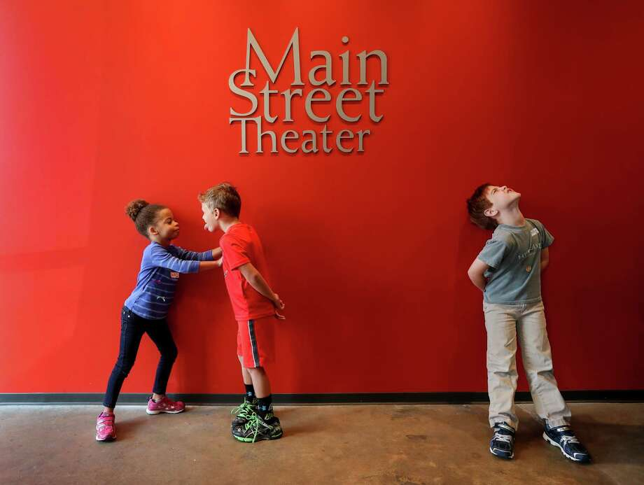 Talia Latimer, 5, from left, plays with Cade Voelte, 6, while Andrew Taaffe, 6, waits nearby, during Hurricane Camp at the Main Street Theater, Wednesday, Sept. 6, 2017, in Houston. ( Jon Shapley  / Houston Chronicle ) Photo: Jon Shapley, Staff / © 2017 Houston Chronicle