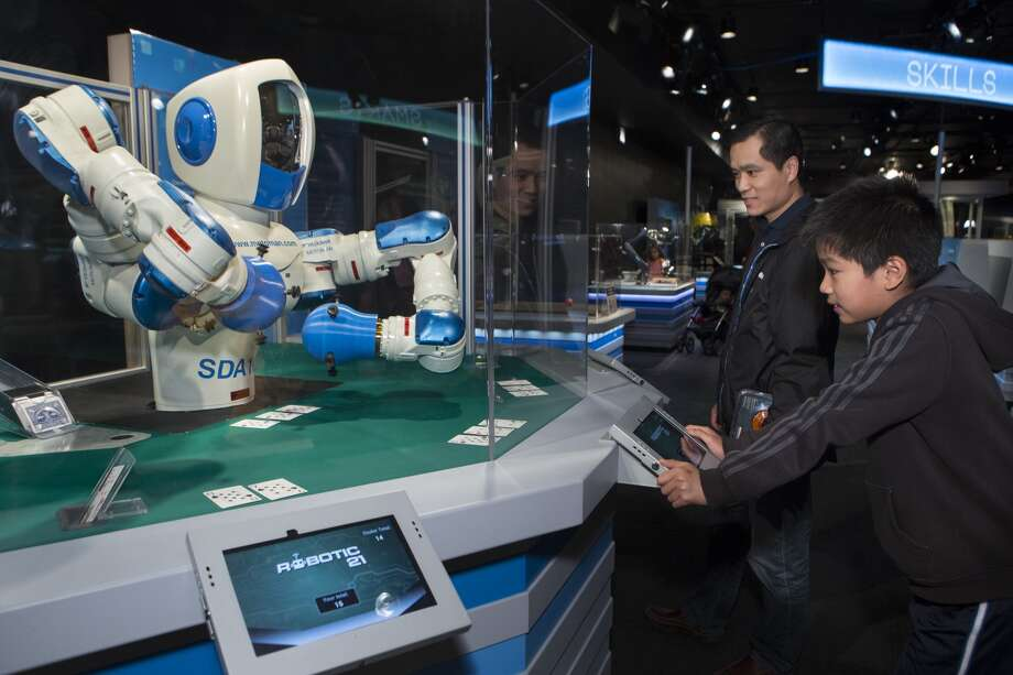 Guests can challenge an industrial robot to a game of blackjack. Photo: J.B. Spector/Museum Of Science And Industry