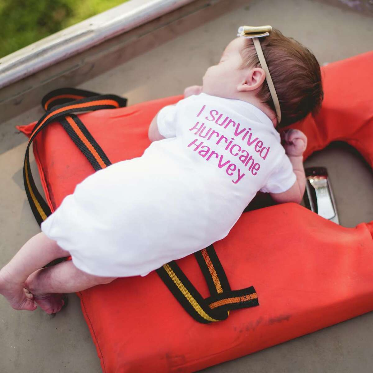 Baby Hope of Orange, Texas, had her newborn photos taken in a Cajun Navy boat that rescued Hope and her family from Harvey floodwaters on Aug. 30, 2017.