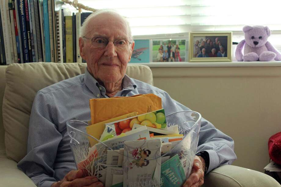 "Arthur ""Bill"" Cornell sits in his apartment at the Watermark in Bridgeport, with a basket of cards he's received for his 100th birthday. Photo: Genevieve Reilly / Hearst Connecticut Media / Fairfield Citizen"