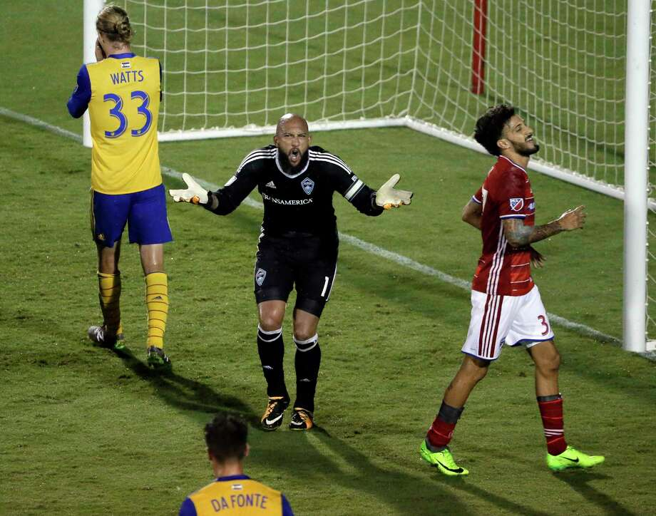 Colorado Rapids goalkeeper Tim Howard, center, reacts to play after an attack by FC Dallas as teammates Jared Watts (33) and Mike da Fonte and FC Dallas forward Maximiliano Urruti, right, walk nearby during the second half of an MLS soccer match, Saturday, Aug. 12, 2017, in Frisco, Texas. (AP Photo/Tony Gutierrez) Photo: Tony Gutierrez, Associated Press / Copyright 2017 The Associated Press. All rights reserved.