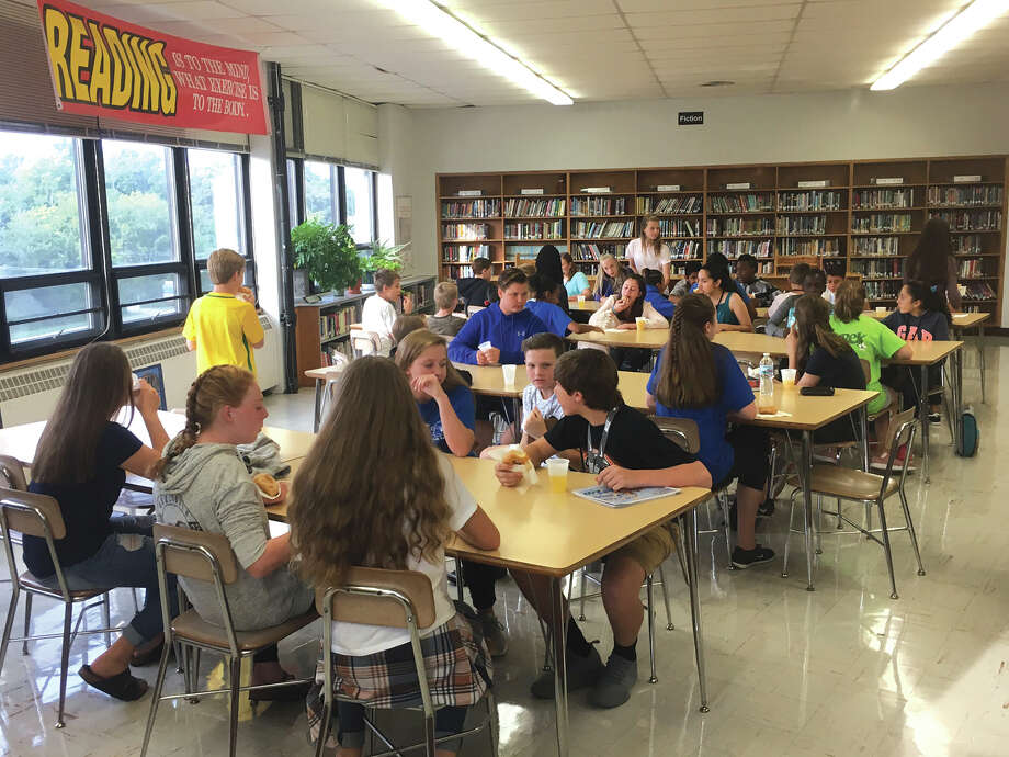 Students new this year to Lincoln Middle School gather in the library recently for a welcome breakfast. Photo: For The Intelligencer