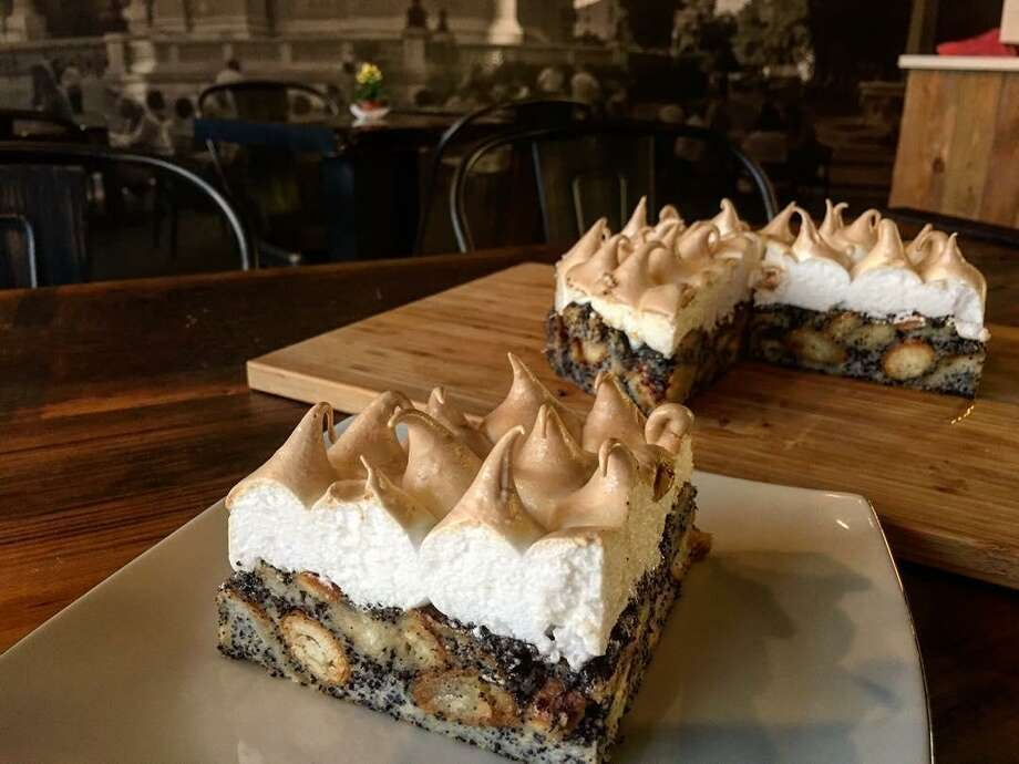 Desserts, including this Oliver Cake, are a specialty at Cafe Dolce in Norwalk, where a giant street mural lends a feeling of the old country. Photo: Contributed Photos