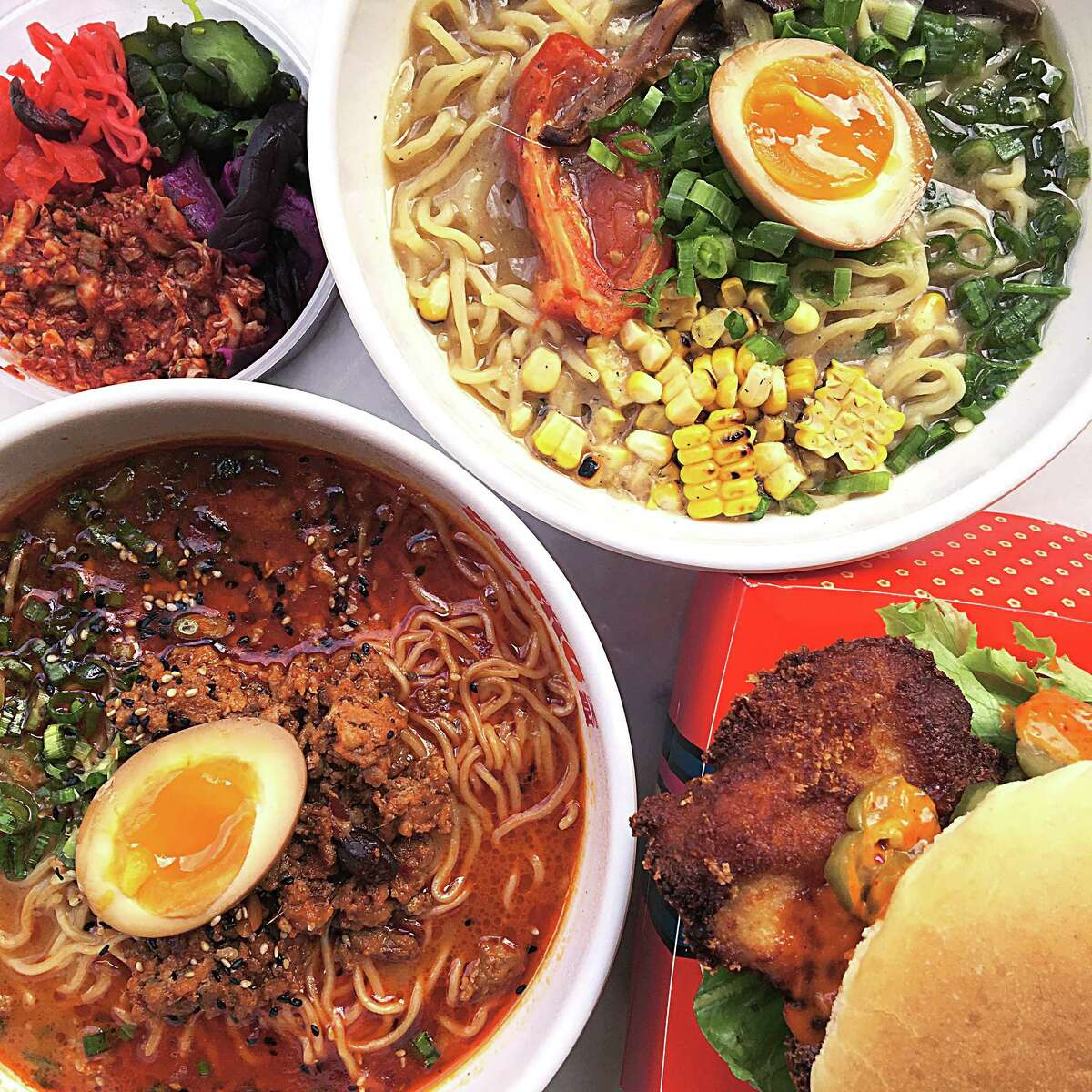 Food from Tenko Ramen at the Bottling Department food hall at The Pearl. Clockwise from top left: kimchi, Double Mushroom ramen, chicken katsu sandwich and Spicy Miso Tantan-men ramen.