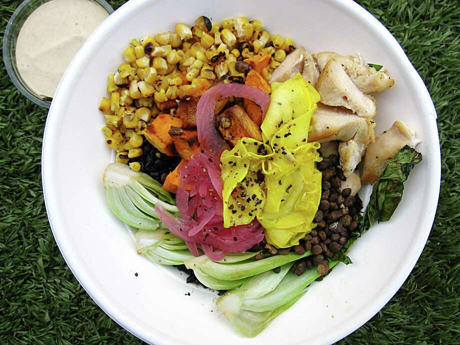 The Good Kind's menu from the Pearl food hall, including a market bowl with black rice, charred corn, bok choy, lentils, squash, sweet potatoes, pickled onions and chicken, will be part of the cafe's second location on South St. Mary's Street at the former home of The Monterey. Photo: Mike Sutter /Staff